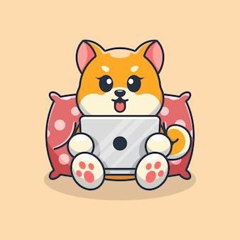 ノートパソコンの漫画を再生するかわいい柴犬犬