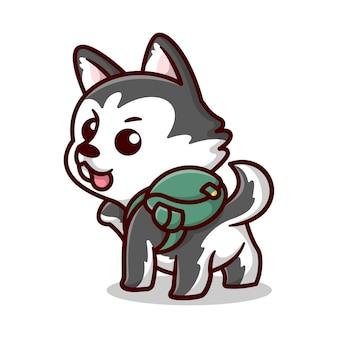 귀여운 시베리안 허스키가 녹색 가방 만화 마스코트를 입고 있습니다.