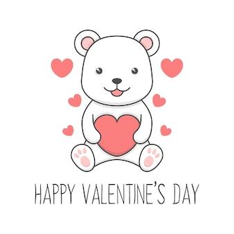 ハートバレンタインデーを保持しているかわいい座っているホッキョクグマ