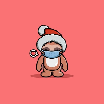 マスクを身に着けているクリスマスを祝うかわいいナマケモノ