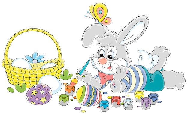 Cute small rabbit coloring beautiful holiday gifts with bright and colorful paints and an art paintbrush