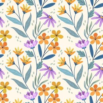 かわいい小さな黄色のオレンジと紫の花のシームレスなパターン。