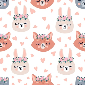 Cute spring seamless pattern with sleeping forest animals heads in wreaths with flowers
