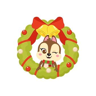 귀여운 다람쥐는 장식 화환으로 크리스마스를 축하합니다