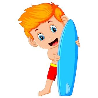Cute surfer man is holding surfboard