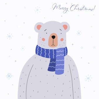 Cute teddy bear in a blue crocheted scarf