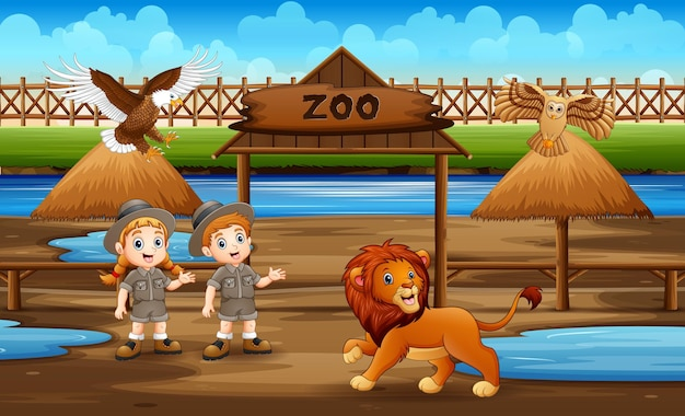動物園の公園で動物と一緒にかわいい飼育係の子供たち