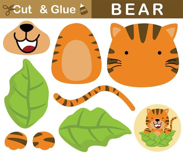 Милый тигр появляется из листьев. развивающая бумажная игра для детей. вырезка и склейка. иллюстрации шаржа
