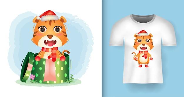 Tシャツデザインのギフトボックスでサンタ帽子とスカーフを使用してかわいい虎のクリスマスキャラクター