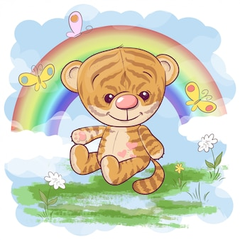 Cute tiger cub with rainbow. cartoon style