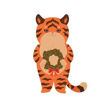 Милый тигр держит рождественский венок, изолированные на белом фоне. векторная графика.