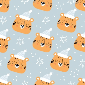 Cute tiger and snowflakes winter seamless pattern on ligth blue background