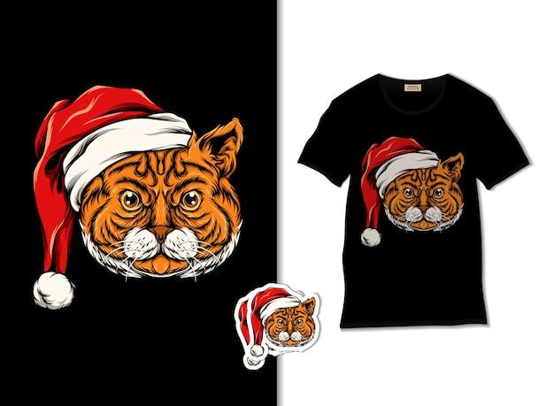Tシャツのデザインのためのサンタクロースの帽子のイラストを身に着けているかわいい虎