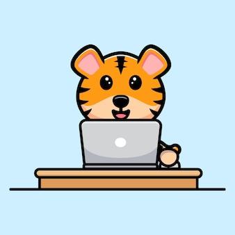 ノートパソコンの漫画のマスコットに取り組んでいるかわいい虎