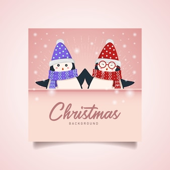 Cute twin penguin christmas background with copyspace