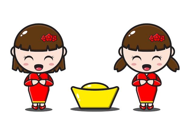 中国の旧正月の金とかわいい2人の中国の女の子