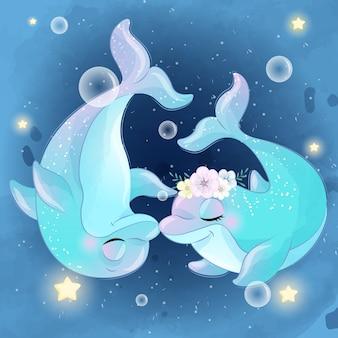 Милые две маленькие дельфины целуются