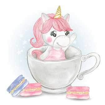 Cute unicorn girl in a glass of tea with macaron