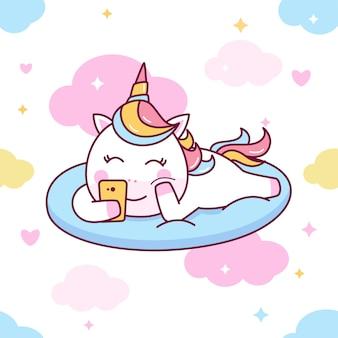Cute unicorn playing smartphone seamless pattern