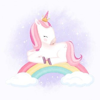 虹の上で眠っているかわいいユニコーン