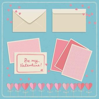 白とピンクの色のイラストで設定されたかわいいバレンタインデーのポストカードと封筒