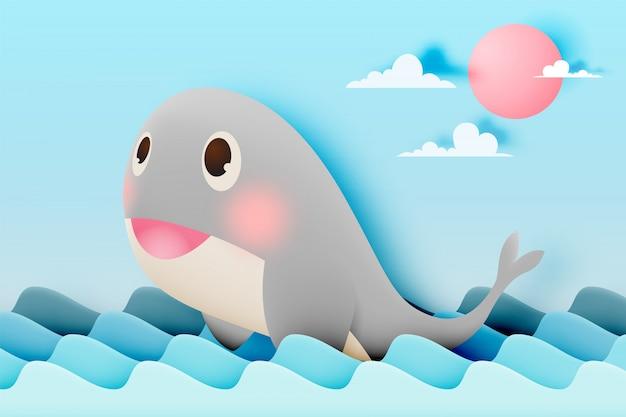 Симпатичный кит с океаном и бумажным стилем фона