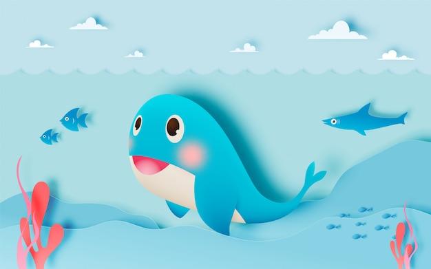 바다와 종이 아트 스타일 배경으로 귀여운 고래