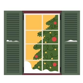 Cute winter window with green shutters
