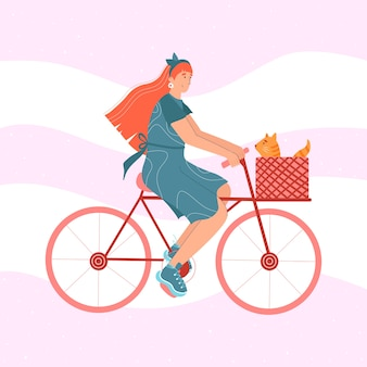 Cute woman is riding a bike with a cat.
