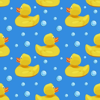 Cute yellow rubber ducks, ducklings and soap bubbles on blue water background seamless pattern.