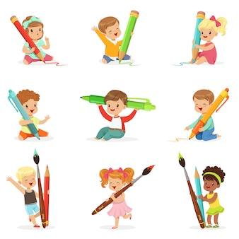Cute young children holding a big pencil and pen
