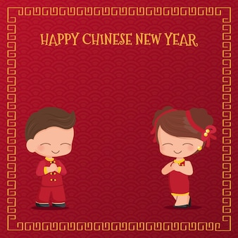 赤い中国の旧正月の伝統的なドレスのかわいい若いカップル