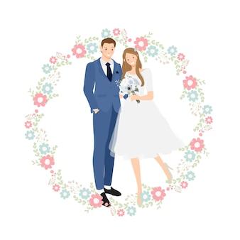 花の花輪と青いスーツでかわいい若い結婚式のカップル