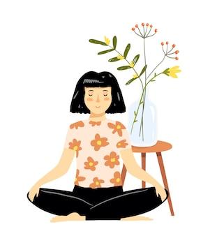 家のインテリアでかわいい若いヨガの女の子や女性の瞑想。