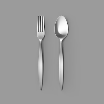 Cutlery set of silver fork and spoon isolated, top view