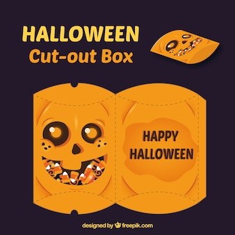 Cutout box of pumpkin with sweets