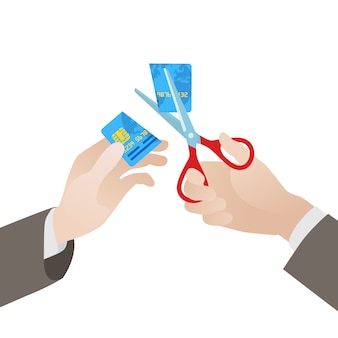 Cutting of the blue credit card in half by scissors
