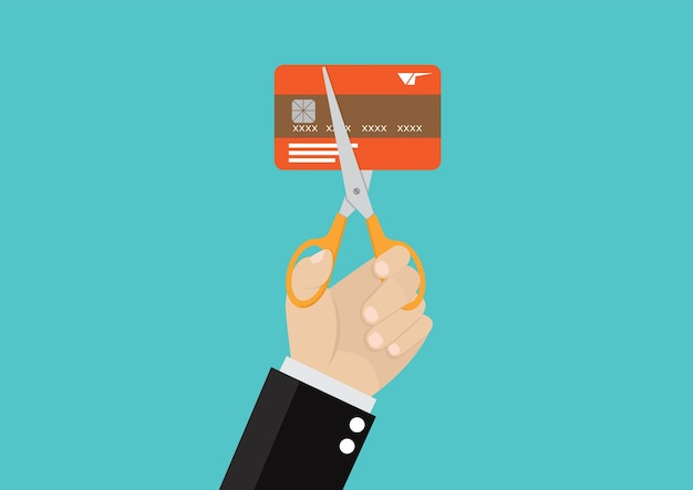 Cutting credit card.