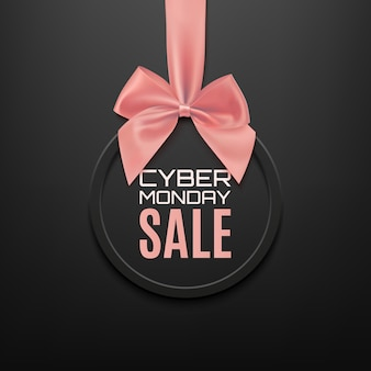Cyber monday sale round banner with pink ribbon and bow, on black background. brochure or banner template.