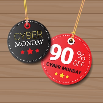 Cyber monday sale tags or labels set on wooden textured design