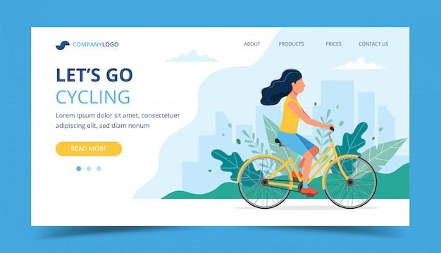 サイクリングランディングページ。公園で女性乗馬自転車。
