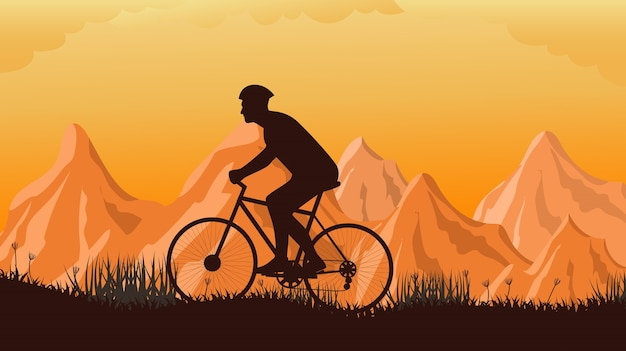 Cyclist silhouette in the mountains