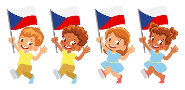 Флаг чехии в руке. дети держат флаг. государственный флаг чехии