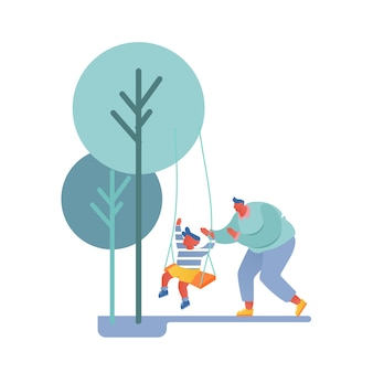 Папа и сын гуляют во дворе, отец качает ребенка на качелях в парке или на детской площадке.