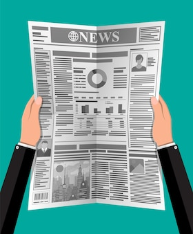Daily newspaper in hands. news journal