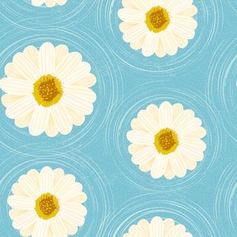 青い背景の上にデイジーの花のシームレスな花柄