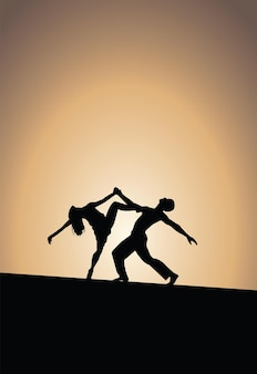 Dancing couple silhouettes, sunset background