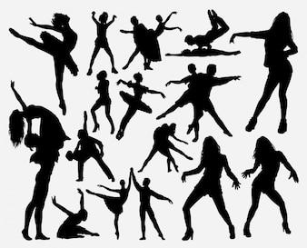 男性と女性のシルエットを踊る