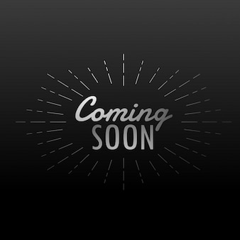 Dark background with coming soon text with rays