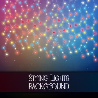 Dark background with decorative string lights.